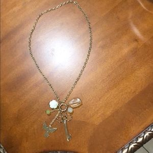 Gold plated multi charm necklace